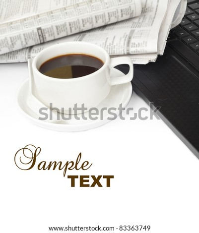 cup of coffee with laptop and newspaper - stock photo