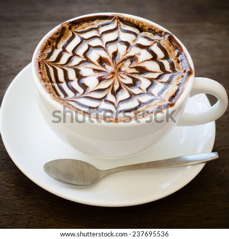 cup of coffee with latte art - stock photo