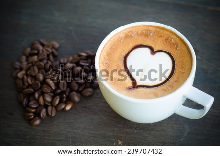 Cup coffee latte art heart coffee stock photo 239707432 shutterstock cup of coffee with latte art and heart coffee beans on wooden background voltagebd Images