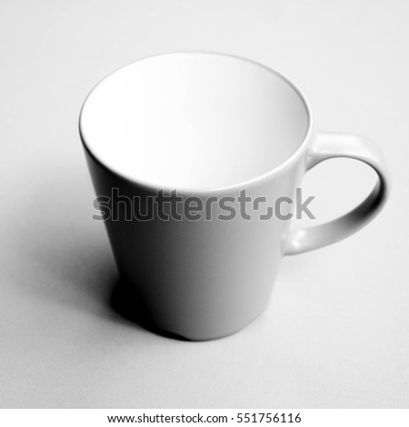 Cup of coffee with shadow - monochrome