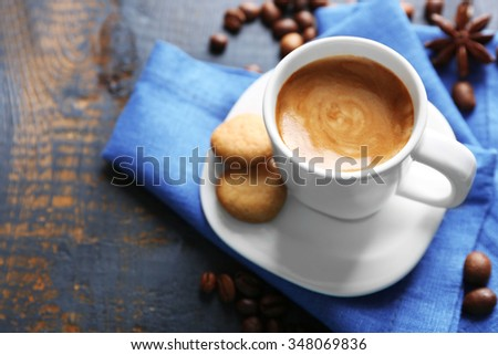 Cup of coffee with spices on wooden table background - stock photo