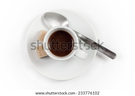 Cup of coffee with spoon and brown sugar, isolated on white background, top view - stock photo