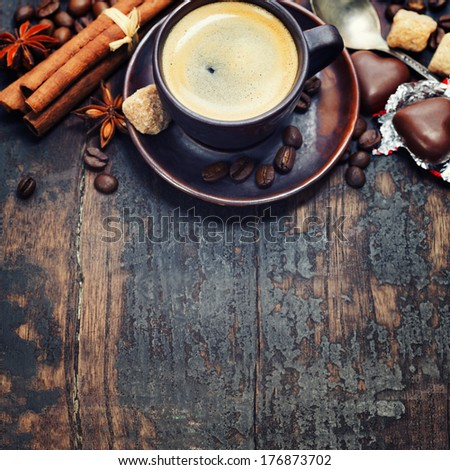 Cup of coffee with sugar, chocolate and spices - Food background - stock photo