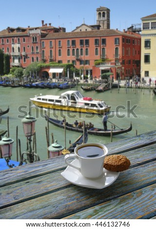 Cup of coffee with Venice view