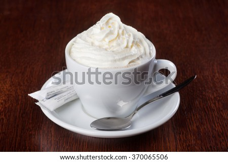 Cup of coffee with whipped cream. Shallow dof - stock photo