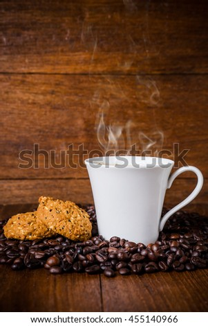 Cup of coffee with whole grains cookies