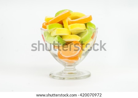 Cup of colorful candies isolated on white background - stock photo