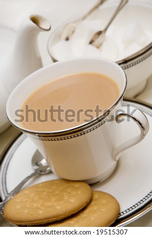 Cup of English tea with biscuits - stock photo