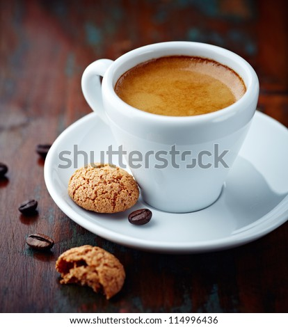 Cup of espresso and biscotti