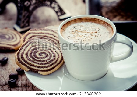Cup of espresso and biscotti on table - stock photo