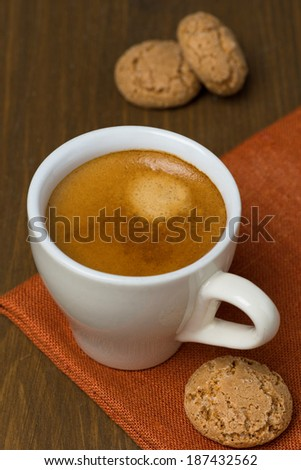 cup of espresso and biscotti, vertical - stock photo