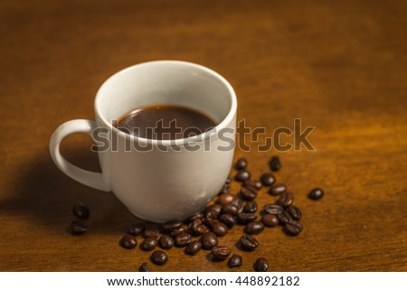 Cup of Espresso and coffee beans