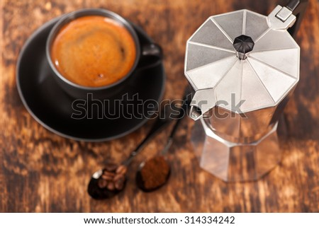 cup of espresso and coffee maker - stock photo