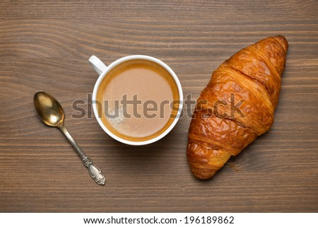 cup of espresso, croissant, concept photo, top view, horizontal - stock photo