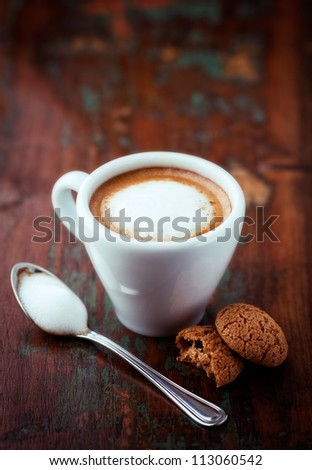 Cup of espresso macchiato with biscotti - stock photo