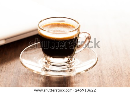 cup of espresso on a wooden background table. - stock photo