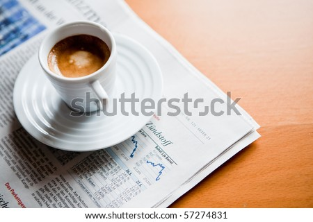 cup of Espresso on newspaper - stock photo