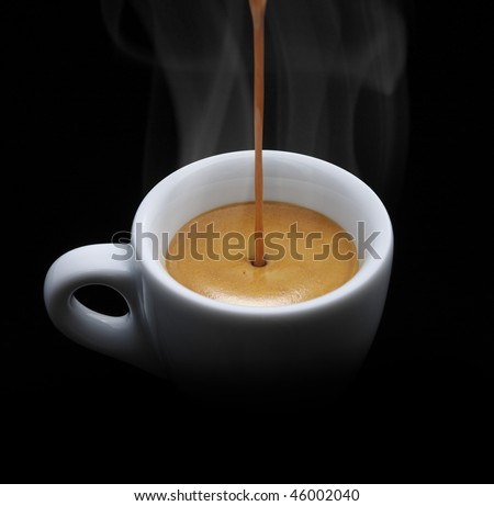 cup of espresso while are filling in a coffee machine, on black background, splash, still life. - stock photo