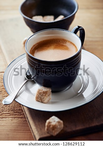 Cup of espresso with brown sugar