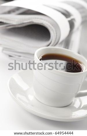 Cup of fragrant coffee on a morning paper business news - stock photo