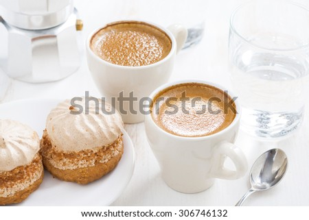cup of fresh espresso and cakes for breakfast, horizontal, close-up - stock photo
