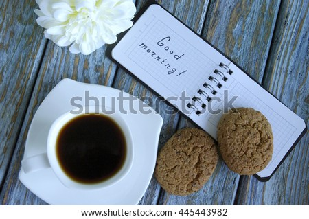 Cup of fresh espresso on rustic wood background