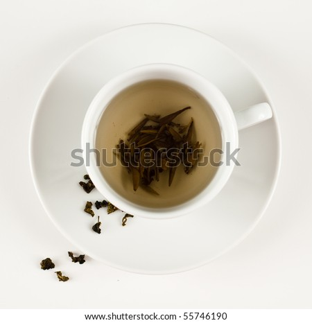 Cup of Freshly Brewed White Green Tea - stock photo
