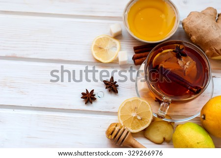 Cup of Ginger tea with lemon and honey on dark blue background, top view   - stock photo