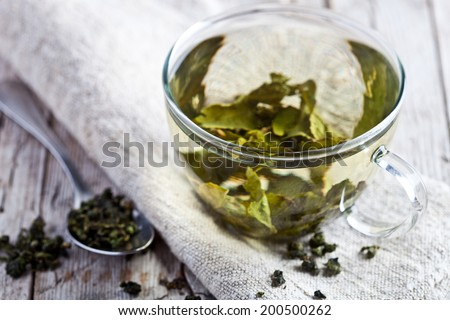 cup of green tea on rustic wooden table