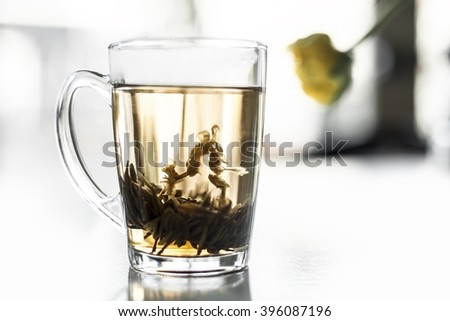 cup of green tea with fresh jasmine