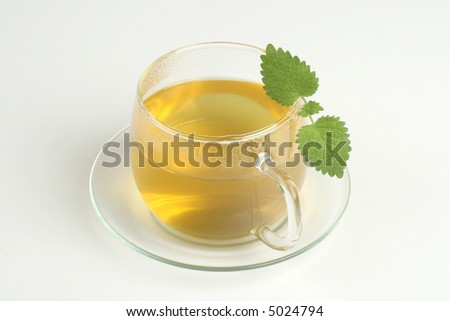 Cup of green tea with herbs