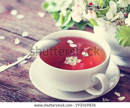 cup of herbal tea with flowers - stock photo