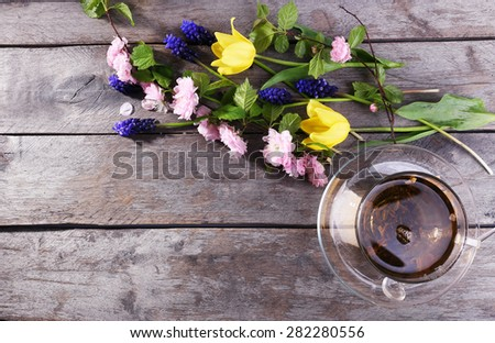 Cup of herbal tea with flowers on wooden table, top view - stock photo