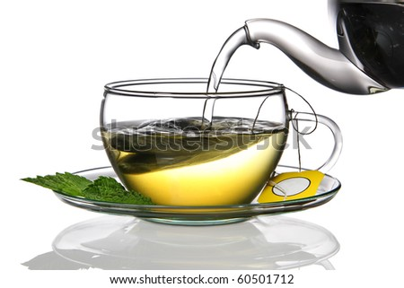 Cup of herbal tea with teabag - stock photo