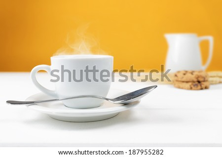 cup of hot beverage on wood table - stock photo