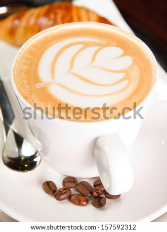 Cup of hot capuccino - stock photo