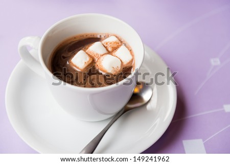 cup of hot chocolate with marshmallows topping