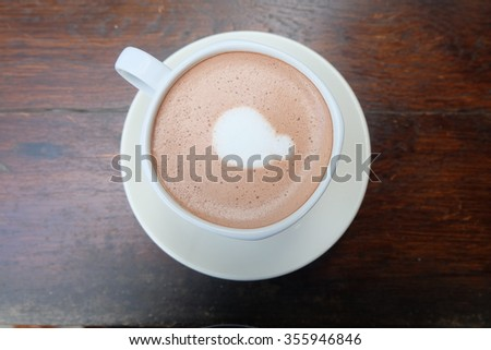 cup of hot cocoa on table