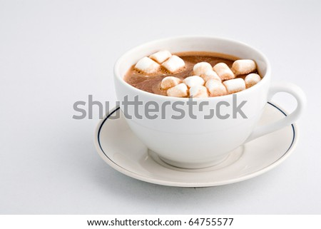 Cup of hot cocoa with marchmallows on white background - stock photo
