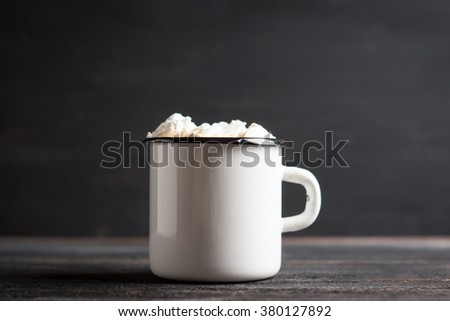 Cup of hot cocoa with marshmallows and chocolate muffins on the dark rustic wooden background. Shallow depth of field. - stock photo