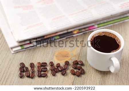 Cup of hot coffee, newspaper and the word news on wooden table - stock photo