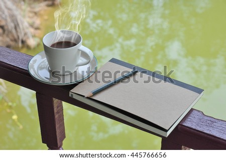 Cup of hot coffee on a wooden,