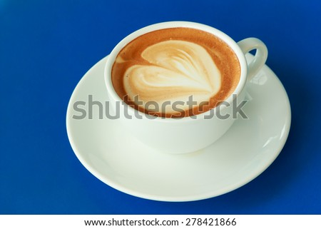 cup of hot coffee on the blue table - stock photo