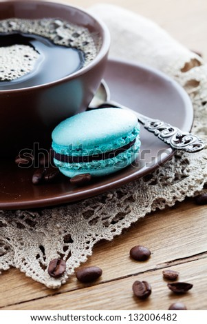 Cup of hot coffee with french macaroon - stock photo