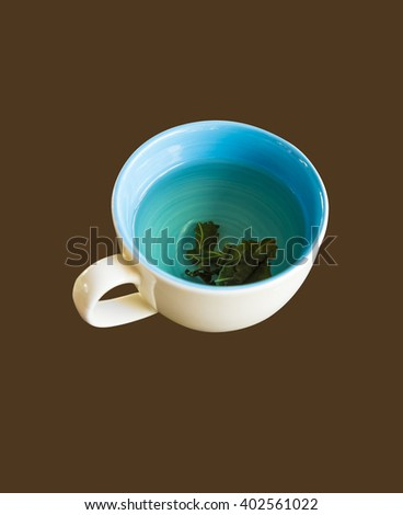 Cup of hot green tea  on brow color  - stock photo