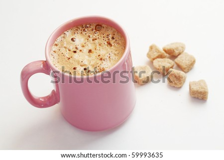 Cup of hot tasty coffee with brown sugar - stock photo