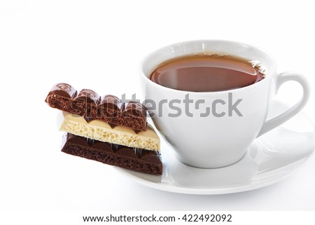 Cup of hot tea and chocolate bars on white background