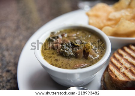 Cup of Kale and Potato Soup Served at Restaurant - stock photo