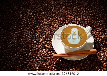Cup of latte art, coffee and coffee beans - stock photo