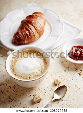 Cup of Latte Coffee and Croissant  - stock photo